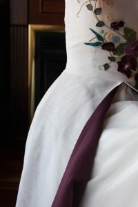 Tara Lynn lined the skirt with a contrast color to pop match the poppies on this hemp silk wedding gown.