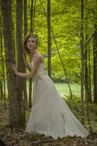 Ethereal wedding dress by Tara Lynn Bridal made of hemp, organic silk and wispy beaded flowers.