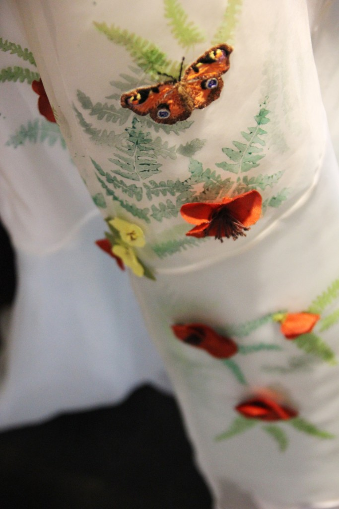 Wearable art wedding dresses by Tara Lynn embroidered with butterflies.